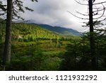 adirondack mountains on a moody ... | Shutterstock . vector #1121932292