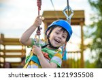 young boy playing and having... | Shutterstock . vector #1121935508