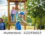 adorable little boy enjoying... | Shutterstock . vector #1121936015