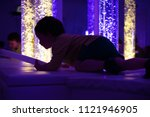 young kid exploring a multi... | Shutterstock . vector #1121946905