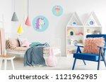furry pink pillow on a vibrant...   Shutterstock . vector #1121962985