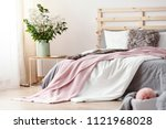 king size bed with grey sheets... | Shutterstock . vector #1121968028