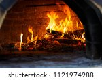italian pizza is cooked in a... | Shutterstock . vector #1121974988