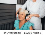 senior woman getting a hearing... | Shutterstock . vector #1121975858