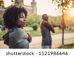 black couple doing exercise... | Shutterstock . vector #1121986646