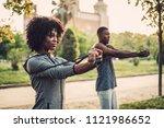 black couple doing exercise... | Shutterstock . vector #1121986652