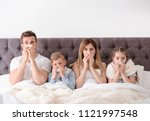 family suffering from cold in... | Shutterstock . vector #1121997548