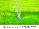 drip irrigation system in a... | Shutterstock . vector #1122000962