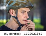 man cyclist is wearing a sports ... | Shutterstock . vector #1122021962