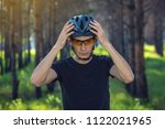 man cyclist is wearing a sports ... | Shutterstock . vector #1122021965