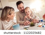 cheerful young family drawing... | Shutterstock . vector #1122025682