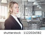 a businesswoman using diagrams... | Shutterstock . vector #1122026582