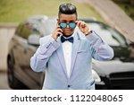stylish arabian man in jacket ... | Shutterstock . vector #1122048065