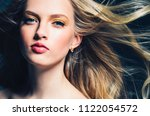 blonde woman with beautiful fly ... | Shutterstock . vector #1122054572