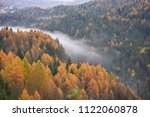 the low clouds near the river... | Shutterstock . vector #1122060878