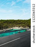 asphalt road and lake   Shutterstock . vector #1122065312