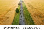 road between the wheat fields | Shutterstock . vector #1122073478
