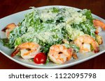 caesar salad with prawn and...   Shutterstock . vector #1122095798