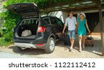 smiling caucasian couple walks... | Shutterstock . vector #1122112412