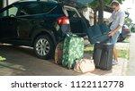 lens flare  joyful man unloads... | Shutterstock . vector #1122112778