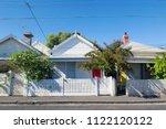 row of detached bungalow homes...   Shutterstock . vector #1122120122