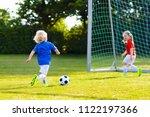 kids play football on outdoor... | Shutterstock . vector #1122197366