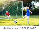 kids play football on outdoor...   Shutterstock . vector #1122197612