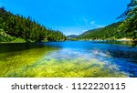 the crystal clear waters of... | Shutterstock . vector #1122220115