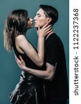 portrait of a kissing... | Shutterstock . vector #1122237368
