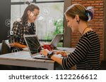 focus on woman use computer... | Shutterstock . vector #1122266612