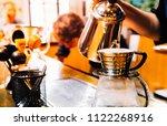 women barista to make a drip...   Shutterstock . vector #1122268916