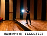 young actor in a theater. | Shutterstock . vector #1122315128