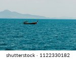 motor boat and island in the sea | Shutterstock . vector #1122330182