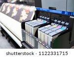 color ink cartridge in the... | Shutterstock . vector #1122331715