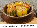 baked zucchini stuffed with... | Shutterstock . vector #1122332378