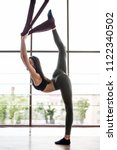 fly yoga concept. young woman... | Shutterstock . vector #1122340502