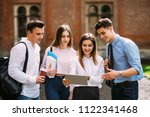 group of college students with... | Shutterstock . vector #1122341468
