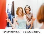 two happy pretty women shopping ... | Shutterstock . vector #1122385892