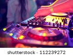 Stock photo dj mixing in night club 112239272