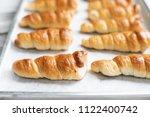 baking horn bread  on  baking... | Shutterstock . vector #1122400742