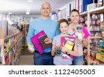 family with schoolgirl holding... | Shutterstock . vector #1122405005