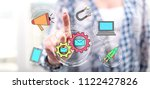 woman touching a digital... | Shutterstock . vector #1122427826