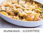 delicious potato casserole on... | Shutterstock . vector #1122457052