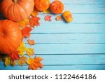 pumpkins and autumn leaves on... | Shutterstock . vector #1122464186