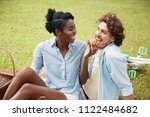 laughing black woman giving... | Shutterstock . vector #1122484682