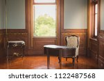 desk and chair in antique... | Shutterstock . vector #1122487568