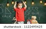 kindergarten graduation concept.... | Shutterstock . vector #1122495425