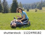 man and woman having fun on... | Shutterstock . vector #1122498182