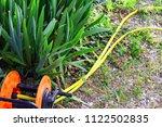 garden irrigation hose | Shutterstock . vector #1122502835
