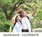 senior couple travel together... | Shutterstock . vector #1122506678